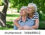 senior couple embracing in park | Shutterstock . vector #568688812
