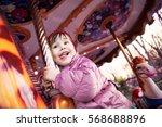 Happy Little Girl On Carousel...