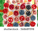 fruit and berry tartlets... | Shutterstock . vector #568689598