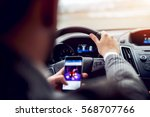 man looking at mobile phone... | Shutterstock . vector #568707766