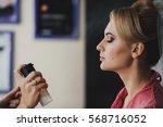 the makeup artist doing a... | Shutterstock . vector #568716052