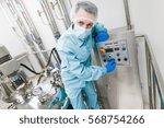scientist in blue lab suit... | Shutterstock . vector #568754266