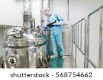 scientist in blue lab suit... | Shutterstock . vector #568754662