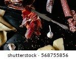 tasty sliced prosciutto crudo...   Shutterstock . vector #568755856