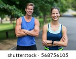 fit people posing with crossed... | Shutterstock . vector #568756105