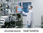 factory worker in white suit is ... | Shutterstock . vector #568764856