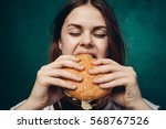 happy woman eating greasy food  ... | Shutterstock . vector #568767526