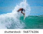 riding the waves. a big jump.... | Shutterstock . vector #568776286