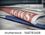 stacked newspapers. on one in... | Shutterstock . vector #568781608