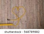 heart of yellow headphones... | Shutterstock . vector #568789882