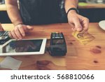 man keeping plastic card while... | Shutterstock . vector #568810066