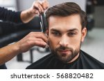 skillful hairdresser cutting... | Shutterstock . vector #568820482