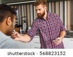 benevolent bearded man in cafe | Shutterstock . vector #568823152