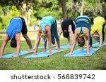 fitness class practicing yoga...   Shutterstock . vector #568839742