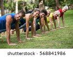 fitness class practicing yoga...   Shutterstock . vector #568841986