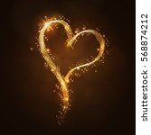 glowing golden heart on a dark...