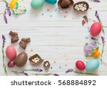 easter eggs over blue wooden... | Shutterstock . vector #568884892