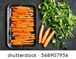 roasted carrots with green... | Shutterstock . vector #568907956
