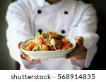chef proudly presenting thai...   Shutterstock . vector #568914835