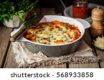Stock photo baked stuffed conchiglioni with tomato sauce rustic style 568933858