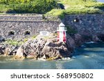 small lighthouse on rock and... | Shutterstock . vector #568950802