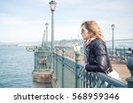 young attractive serious woman... | Shutterstock . vector #568959346