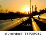 golden pipes going to crude oil ... | Shutterstock . vector #569009362