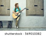 Young Woman Playing Acoustic...