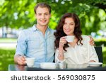happy couple drinking a... | Shutterstock . vector #569030875