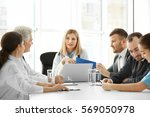 team of doctors having meeting... | Shutterstock . vector #569050978