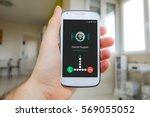 man's hand holding smartphone... | Shutterstock . vector #569055052