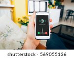 hand holding smartphone at home ... | Shutterstock . vector #569055136