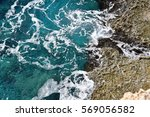 Waves Crashing On Rocks On...