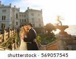 bride and groom at castle | Shutterstock . vector #569057545