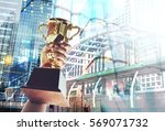 win concept man holding up a... | Shutterstock . vector #569071732