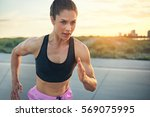 fit determined young woman... | Shutterstock . vector #569075995