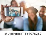 close up phone in male hand... | Shutterstock . vector #569076262