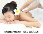 young woman getting a massage... | Shutterstock . vector #569100265