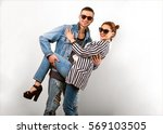 fashion couple in sunglasses... | Shutterstock . vector #569103505