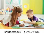 young female psychologist... | Shutterstock . vector #569104438