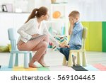 young female psychologist... | Shutterstock . vector #569104465