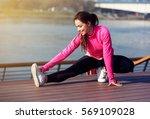 woman runner stretching legs... | Shutterstock . vector #569109028