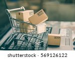 cartons in a shopping cart on a ... | Shutterstock . vector #569126122