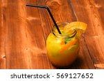 cold lemonade with oranges... | Shutterstock . vector #569127652