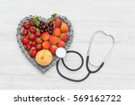 healthy fruits for heart in... | Shutterstock . vector #569162722