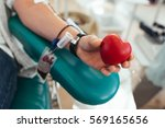 blood donor squeezes the rubber ... | Shutterstock . vector #569165656