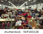 industrial busy sewing workplace | Shutterstock . vector #569183128