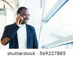 african man talking on mobile... | Shutterstock . vector #569227885
