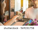 customer young man and woman... | Shutterstock . vector #569231758