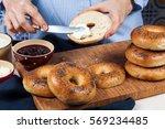 hands spread cream cheese fresh ... | Shutterstock . vector #569234485